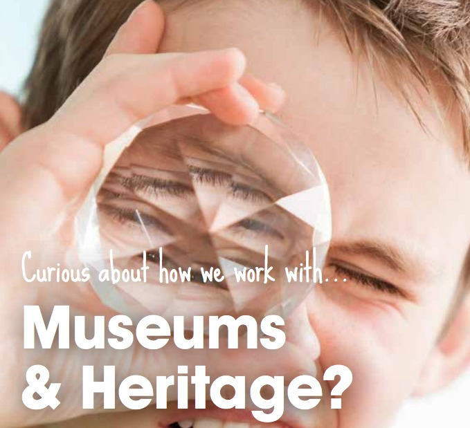 "Young boy squinting with one eye and looking through a kaleidoscopic object with the other eye. Text reads: ""Curious about how we work with... Museums & Heritage?"""